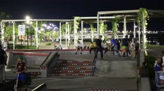 Teens at Lighted Skateboard Park at Night Stock Footage