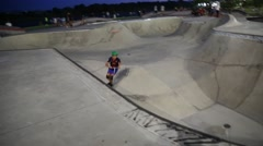 Teen Girl on Castor Skooter at Skateboard Park Stock Footage