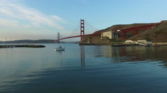 Sailboat and Golden Gate Bridge in San Fransisco, California, aerial shot Stock Footage