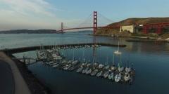 Boat marina and Golden Gate Bridge in San Fransisco, California, aerial shot Stock Footage