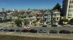 Painted Ladies famous Victorian row houses in San Fransisco, California, aerial Stock Footage