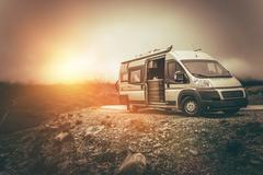 RV Camper Journey North. Scenic Mountain Landscape Camper Camping. Motorcoach Stock Photos