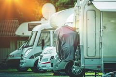 RV Camper Storage Place. Stored Recreational Vehicles on the Storage Parking Stock Photos