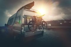 The Ultimate Camper Camping. Modern Camper with Bike on a Bike Rack and Kayak Stock Photos