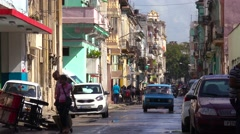 The narrow streets of Old Havana, Cuba, with classic car foreground. Stock Footage
