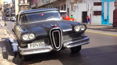 An old fashioned Edsel car sits on the streets of Havana, Cuba. Stock Footage