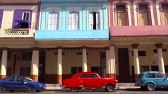 A beautiful colorful shot of the old city of Havana, Cuba with classic old cars Stock Footage