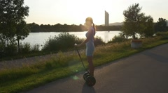 Young woman on gyroscooter Stock Footage