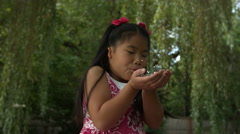 Young girl blowing glitter in slow motion Stock Footage
