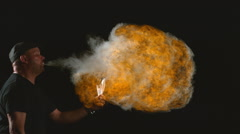 Man breathing fire in slow motion, shot at 1000 frames per second on Phantom Stock Footage
