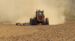 Tractor plowing field in slow motion Stock Footage
