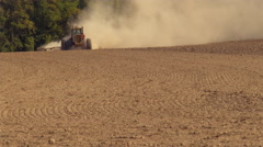 Tractor plowing field in slow motion Stock Footage