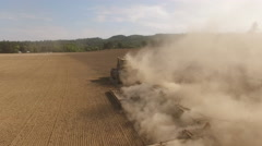 Tractor plowing dusty field aerial view Stock Footage