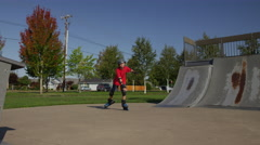 Boy Rollerblading at park Stock Footage