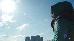 Girl walking at the sunny winter morning with blue sky and singing  Stock Footage