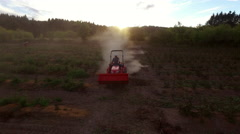Farmer mowing dusty crops on tractor Stock Footage