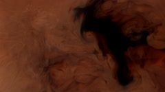 Coffee creamer swirling in coffee, shot with Phantom Flex 4K at 1000 frames per Stock Footage