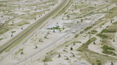 Aerial view of Lost Hills oil donkeys near Los Angeles, Stock Footage