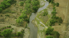 Aerial view of natural river winding through the countryside Stock Footage