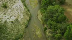 Aerial shot of river on farm land California Stock Footage