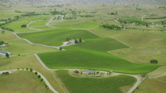 Aerial shot of fields with various types of agriculture Stock Footage