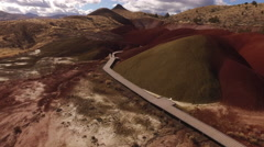 Aerial view of man walking on pathway at the Painted Hills, Oregon Stock Footage