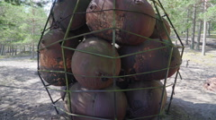 Naval mines inside a net hanging Stock Footage