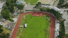 Aerial view of Californian athletic track in college or school. Stock Footage