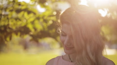 Delicious girl with freckles in a park at sunset Stock Footage