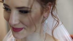 Bride wears earrings, laughing Stock Footage