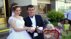 Bride and groom released white doves into the sky Stock Footage