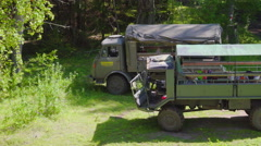 Two military truck parking on the forest Stock Footage
