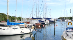 Panning shot from a small harbor with small yachts Stock Footage