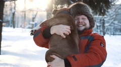 Man hugging his dog at sunny day Stock Footage