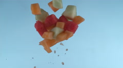 Melon pieces flying in slow motion, shot with Phantom Flex 4K at 1000 frames per Stock Footage