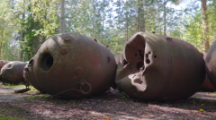 Big naval mines on the middle of the forest Stock Footage