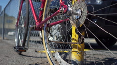 Bicycle Locked against a fence Stock Footage