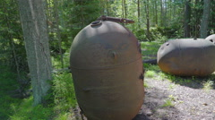 One of the many naval mines found in the forest Stock Footage