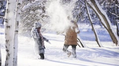 Man and girl have a snowball fight Arkistovideo