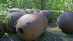 The many naval mines in the middle of trees Stock Footage