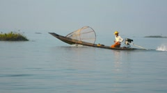 Burmese Fisherman Piloting his Boat in the Early Morning Light Stock Footage