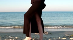 Beautiful girl model walks on the shore beach Stock Footage