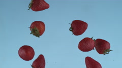 Strawberries flying in slow motion, shot with Phantom Flex 4K at 1000 frames per Stock Footage