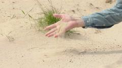Man Picks up Single Handful of Sand on the Beach Stock Footage