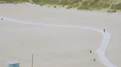 Aerial view of cyclist on beach. Stock Footage