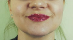View of woman with red pomade on lips sing in front camera. Mouth. Expression Stock Footage