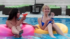 Cocktail party at the pool, the girls swim Stock Footage