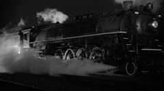 Steam locomotive at night  in black and white Stock Footage