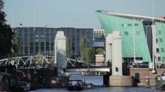 A busy bridge in a harbor in Amsterdam located near NEMO. Stock Footage