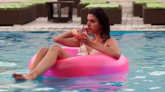 Girl drinks a cocktail, relax, swimming pooll Stock Footage